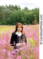young woman in the wild flowers field