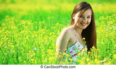 Young woman in the yellow meadow.