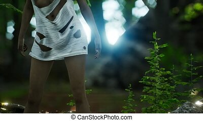 young woman in torn t-shirt in green forest