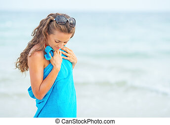 Young woman in towel at seaside