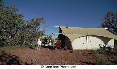 Young woman in towel near tent camping