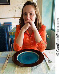 Young woman in tunisian restaurant