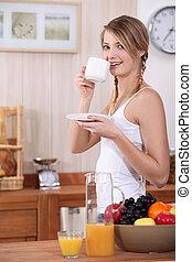 young woman in underwear having breakfast