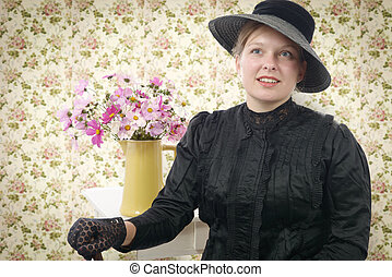 young woman in vintage costume 1900s