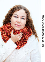 Young woman in warm clothes with a sore throat, white background
