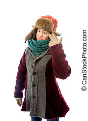 Young woman in warm clothing and staring at point of hand gun