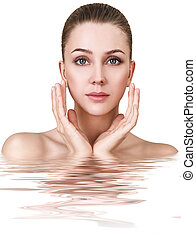 Young woman in water with crystal clear surface.
