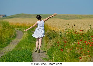 young woman in wheat field at summer - Young woman standing...