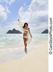 young woman in white bikini and chiffon