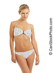 Young woman in white bikini