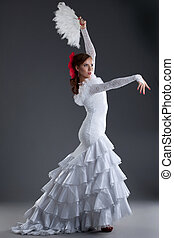 Young woman in white dress performing flamenco