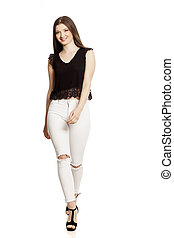 Young woman in white jeans