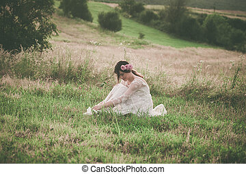 young woman in white lacy dress on meadow - young beautiful...