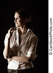 Young woman in white shirt