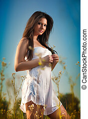 Young woman in wild field