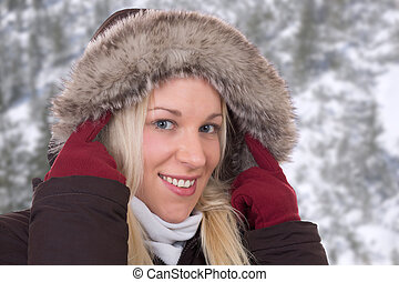 Young woman in winter wearing a fur collar
