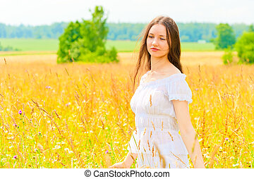young woman in yellow flower field