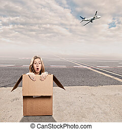 inside a box at airport - young woman inside a box at...