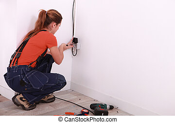 Young woman installing wiring