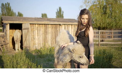 Young woman interacts with animals