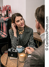 Young woman interested in conversation with her partner