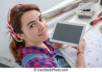 young woman interior designer using digital tablet