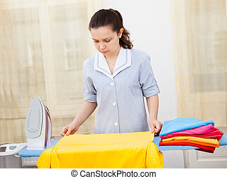 Young Woman Ironing Clothes