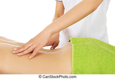 Young woman is being massaged.