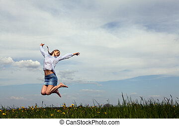 young woman is happy outdoor in summer