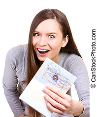 Young woman is happy to get a visa in her passport - Happy...