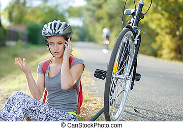 young woman is having a problem with her bike
