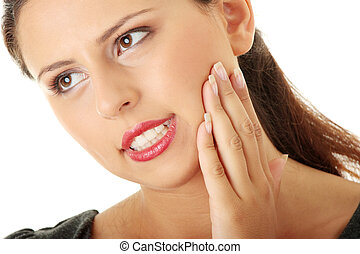 Young woman is having toothache - Young woman in pain is...