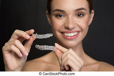 Young woman is holding artificial plastic jaw