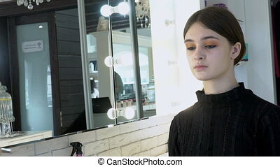 Young woman is on cosmetology procedure in beauty studio...