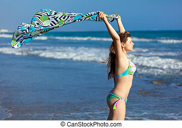 Young woman is on the beach