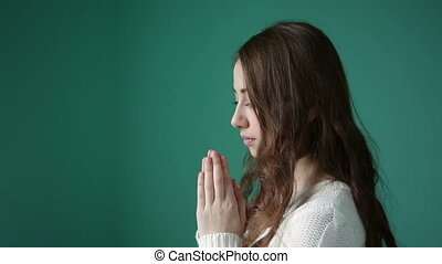 young woman is praying