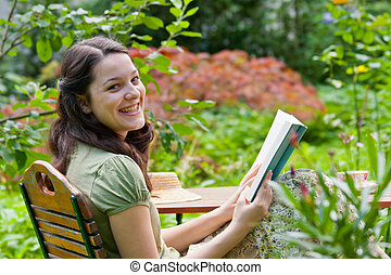Young woman is reading
