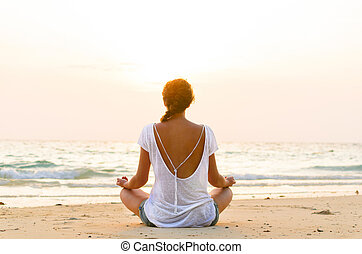 sitting on beach at sunrise