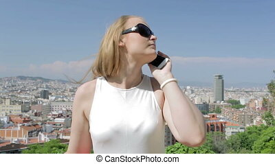 Young woman is speaking on the phone.