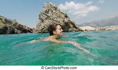 young woman is swimming in the Adriatic Sea