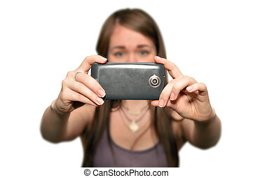 Young woman is taking photos with the mobile phone camera, isolated on white background