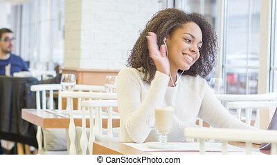 Young woman is talking on Skype. - Digital dialogue. Pretty...
