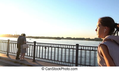 Young woman jogging in sunset - Young woman jogging at the...