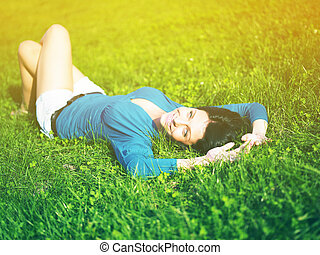 Young woman joy and relaxing in park