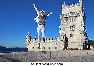 Young woman joyfully jumping