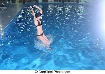 Young Woman jump in Pool