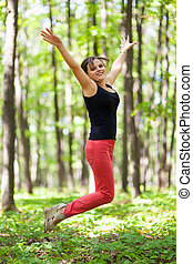 Young woman jumping for joy