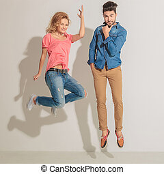 Young woman jumping next to her lover