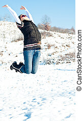Young woman jumping of joy