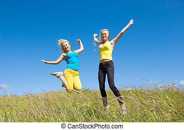 young woman jumping on background blue sky